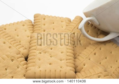 Biscuits with tea cup isolated on white background