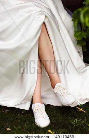 A Close Up Image Of Elegant Floor-length Wedding Dress. Concept Of Bride Morning.