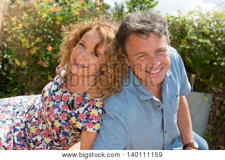 Portrait Of Loving Couple Standing Outdoors Mid Aged