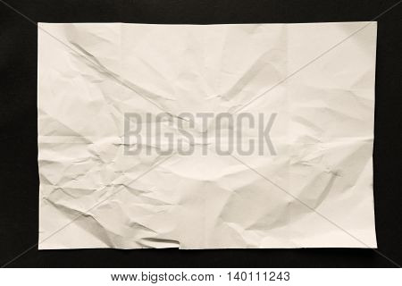 Crumpled paper with folded torn on black background