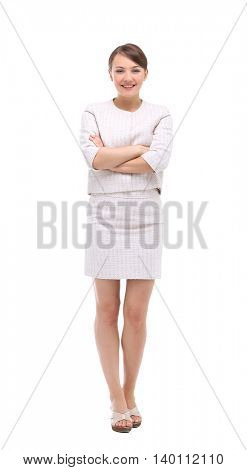 Happy businesswoman wearing beige suit standing and folding arms