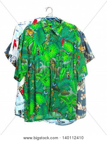 The three isolated tropical shirts on white