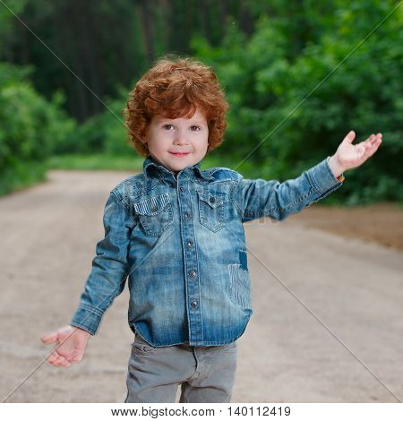 photo of cute little emotional boy outdoors