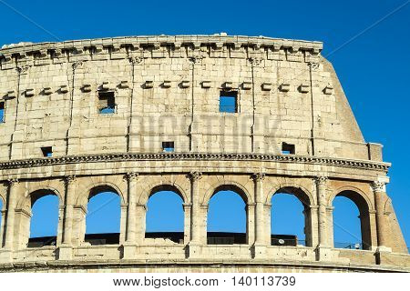 Rome Italy Colosseum upper arches structure. The fourth top storey has no arches but only square windows.