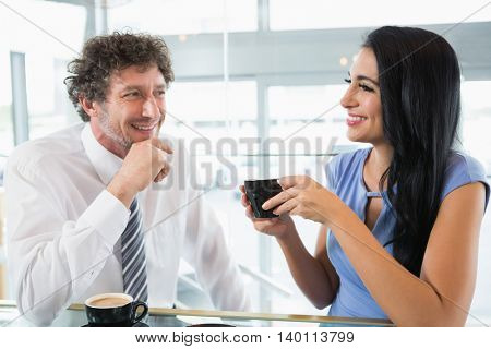 Businessman discussing with colleague in office
