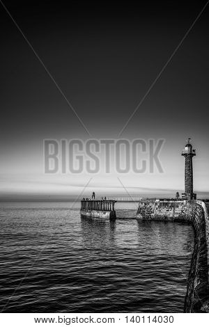 Whitby seascape lighthouse in Yorkshire England UK