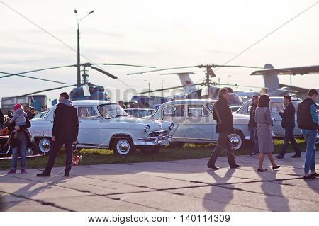 Kiev, Ukraine - 23, April 2016: Many people view old cars and helicopters on exhibition of old cars - OldCarLand 2016.