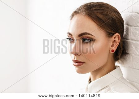 Young beautiful woman face with perfect makeup. Beauty fashion concept