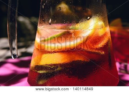 Close-up photography of homemade lemonade with lemon, orange, lime and mint