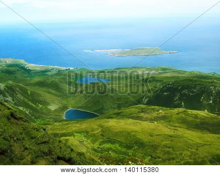 Ocean view from the rolling green hills on the Isle of Skye in Scotland.
