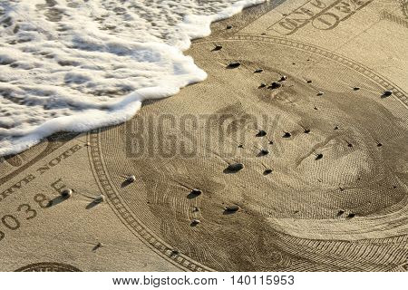 conceptual image of beach with dollar bill