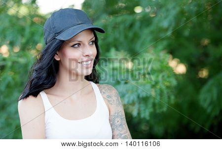 Cool woman with hat and shirt set walking in the forest