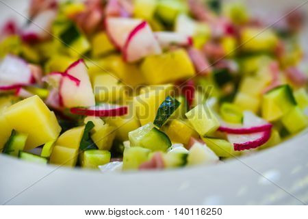 Close-up of fresh rustic vegetable salad served in restaurant