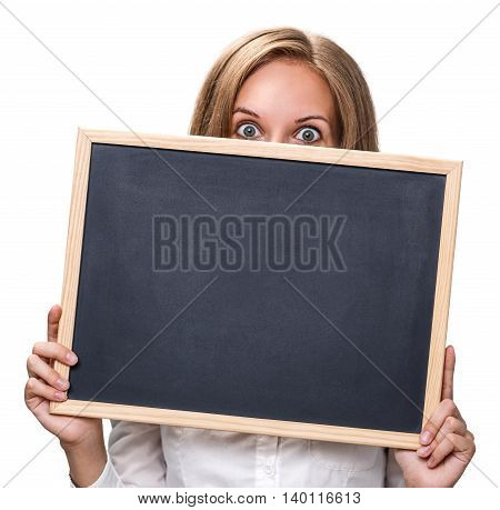 Young pretty girl holding chalkboard with copyspace isolated on white