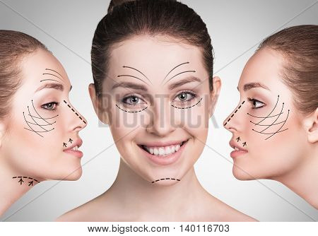 Beautiful faces of young woman with lifting arrows over gray background. Plastic surgery concept