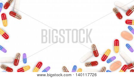 Different colored medicine pills shaped as frame isolated on white background.