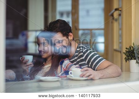 Happy young couple bonding at cafe