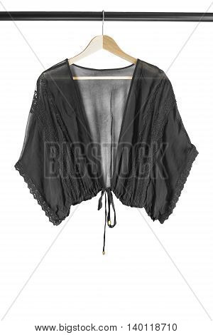 Black chiffon blouse on wooden clothes rack isolated over white