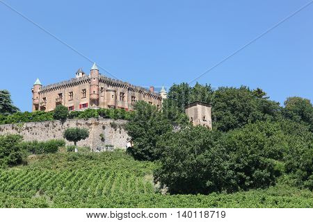Castle of Montmelas on a hill in Beaujolais, France