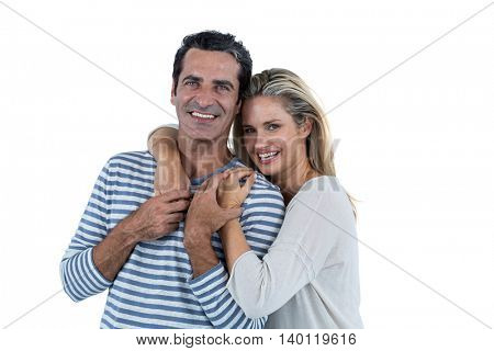 Portrait of Mid adult romantic couple embracing against white background