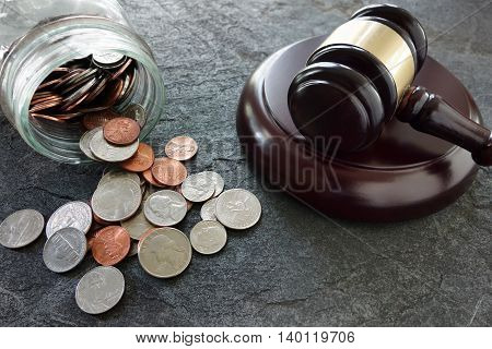 Coins from a coinjar and legal gavel