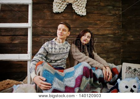 Young Fashion Winter  Couple At Wooden Background