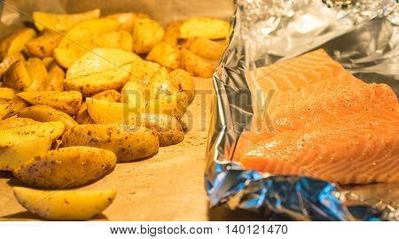 Salmon Fish with rosemary potatoes, baked in the oven. Red Fish.