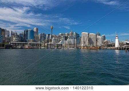 SYDNEY, AUSTRALIA - APRIL, 2016 : View of Cape Bowling Green Lighthouse, Tall Ship HMB Endeavour in front of Australian National Maritime Museum, Darling Harbour, Sydney, Australia on April 21, 2016