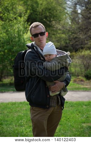 Happyness daddy with the baby in the Park