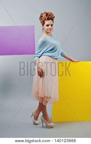 Full Length Studio Portrait Of Young Girl Near Art Colored Blanks.