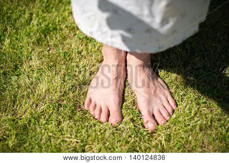 two feet on the very green grass