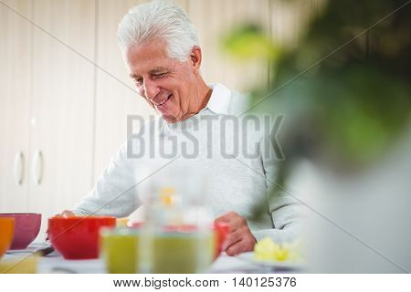 Senior man smiling during the lunch outside