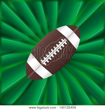 A typical American ball over a green material background