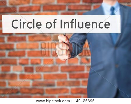 Circle Of Influence - Businessman Hand Holding Sign