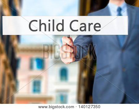 Child Care - Businessman Hand Holding Sign