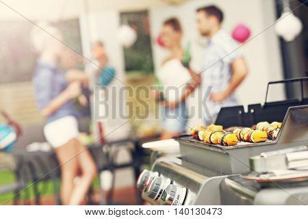 Closeup of grilled shashliks and hamburgers on grate