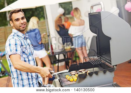 Picture presenting group of friends haviing barbecue party