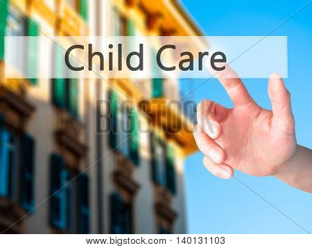 Child Care - Hand Pressing A Button On Blurred Background Concept On Visual Screen.