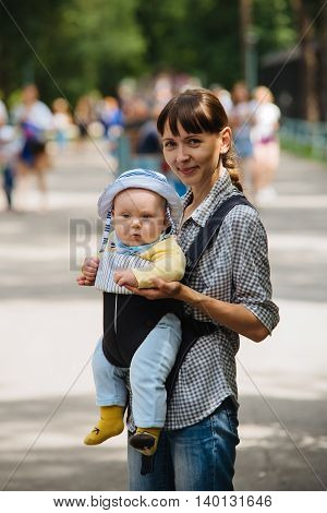 Mom and young son in the sling