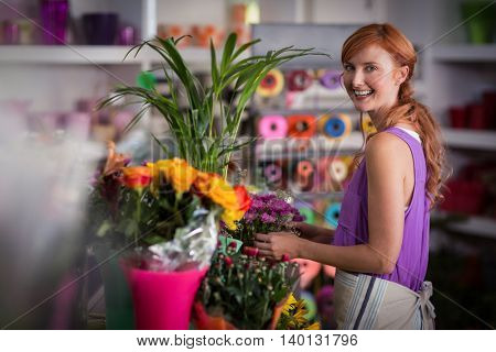 Female florist preparing flower bouquet in the flower shop