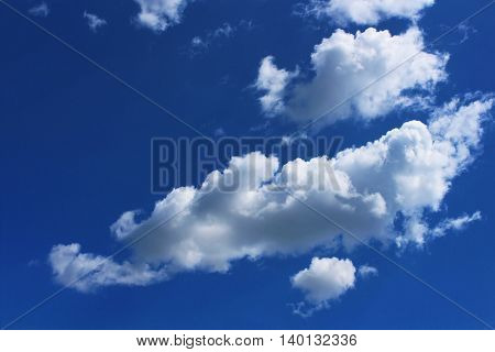 White Cloud Against The Bright Blue Sky