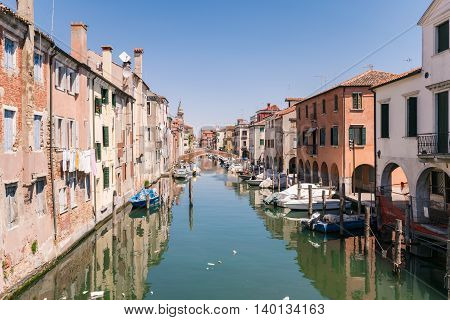 Characteristic canal in Chioggia lagoon of Venice Italy.
