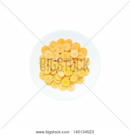Closeup pile of cut fresh carrot on ceramic circle dish isolated on white background with clipping path in prepare for cooking concept in top view
