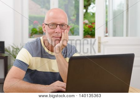 a middle aged man with a laptop