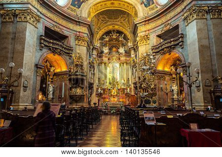 VIENNA, AUSTRIA - FEBRUARY 9, 2016: Inside a St. Peter's Baroque Roman Catholic Church. Beautiful illuminated altar
