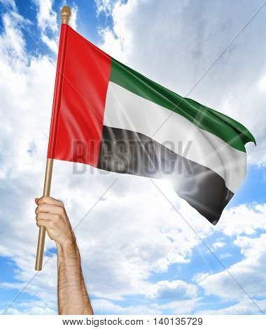 Person's hand holding the Emirati national flag and waving it in the sky, 3D rendering