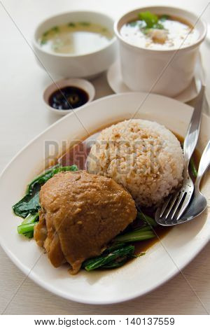 Baked chicken with rice and vegetable and Crysanthemum tea or flower tea in background