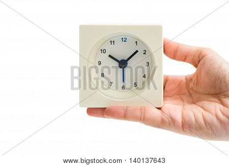 Isolated woman hand hold white alarm square clock at 10 o'clock on white background - business concept of time management