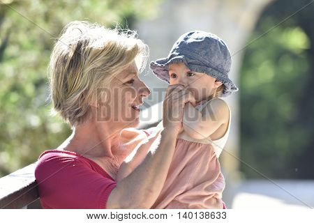 Grandmother enjoying summer day with baby girl