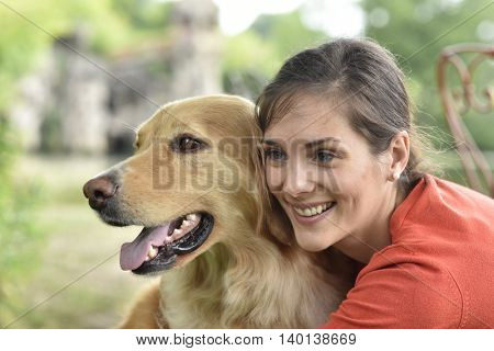 Portrait of woman with dog at the park